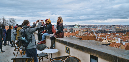 Enjoying the great overlook over Prague from the castle - PRAGUE / CZECH REPUBLIC - MARCH 20, 2017