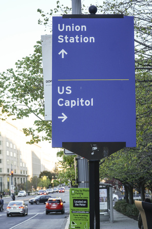 Direction signs to Union station and US Capitol in Washington DC - WASHINGTON DC - COLUMBIA - APRIL 7, 2017 Editorial