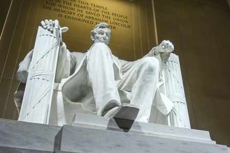 abraham: The statue of Abraham Lincoln sitting in a chair at Lincoln Memorial in Washington