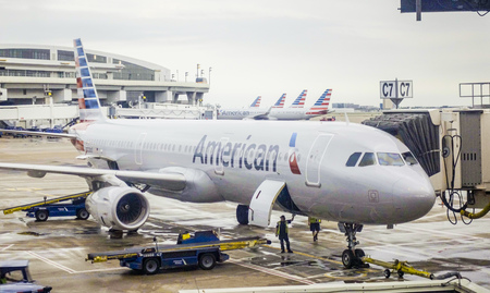 American airlines aircraft waiting at the gate DALLAS - TEXAS - APRIL 10, 2017