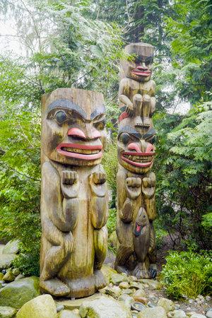 Totem Poles in Capilano Suspension Bridge Park - VANCOUVER - CANADA - APRIL 12, 2017 Editorial