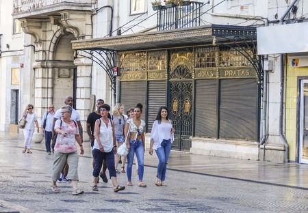 tagus: Walking through the historic district of Lisbon - LISBON - PORTUGAL - JUNE 17, 2017 Editorial
