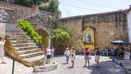 tagus: Tourists walking through St George Castle in Lisbon - LISBON - PORTUGAL - JUNE 17, 2017