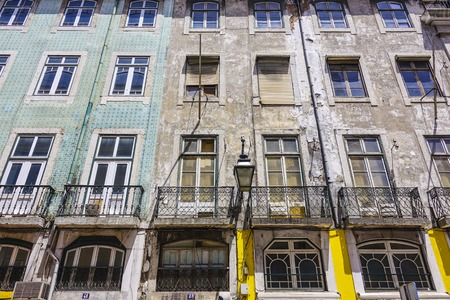 Old house fronts in Lisbon - typical street view - LISBON - PORTUGAL - JUNE 17, 2017
