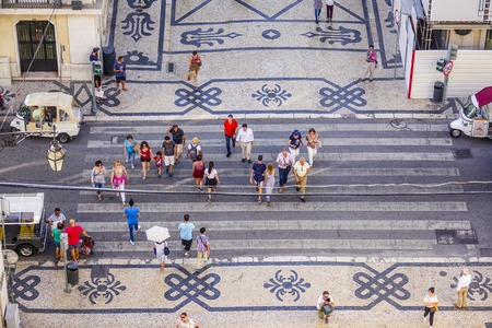 tagus: People crossing the street - aerial view from Augusta Street Arch - LISBON - PORTUGAL - JUNE 17, 2017