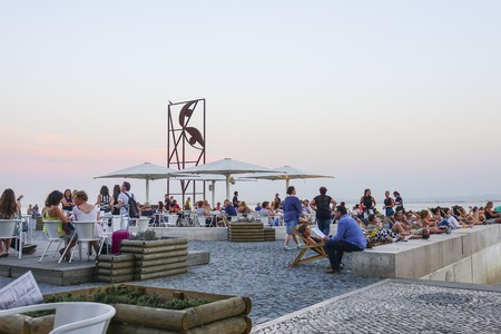 tagus: The popular riverwalk at Almada in Lisbon