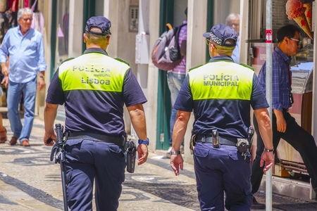tagus: Police Officers in the streets of Lisbon Editorial