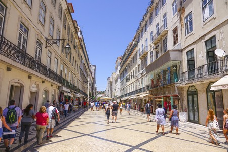 Popular Augusta Street in Lisbon pedestrian zone - a busy place all day