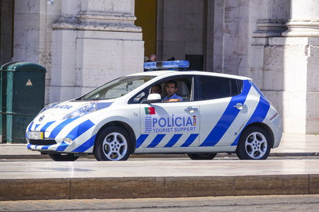 tagus: Tourist support Police Car in Lisbon Editorial