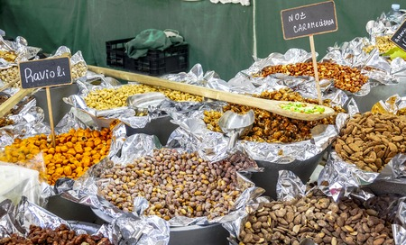 Big choice of nuts and fruits on a market for Portuguese specialties in Lisbon Stock Photo