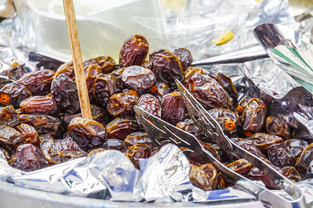 tagus: Dried dates on a fruit market in Lisbon  - LISBON, PORTUGAL - 2017 Stock Photo