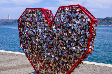 Thousands of Love Locks attached to the Love Sculpture at Tagus Riverwalk in Lisbon Editorial