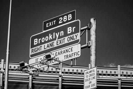 Street direction signs in New York leading to Brooklyn Bridge - MANHATTAN  NEW YORK - APRIL 2, 2017