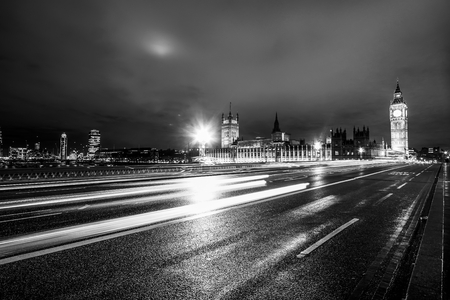 Westminster Bridge London at night with Big Ben and Houses of Parliament Stock Photo