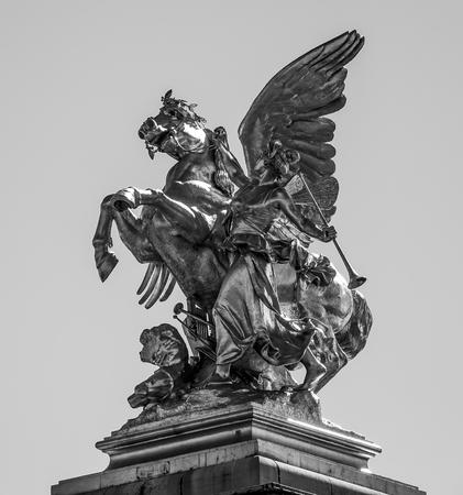 The golden statues on Alexandre III bridge in Paris