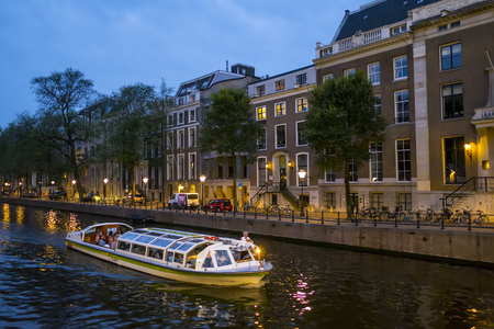 Canal cruise in the city of Amsterdam by night - AMSTERDAM - THE NETHERLANDS - JULY 20, 2017