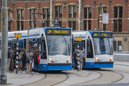 The tram in Amsterdam - departing at Central Station - AMSTERDAM - THE NETHERLANDS - JULY 20, 2017