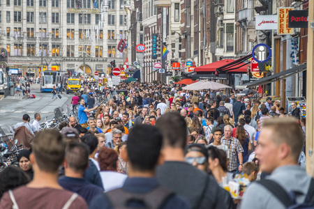 Huge crowd of tourists at famous Damrak street in Amsterdam - AMSTERDAM - THE NETHERLANDS - JULY 20, 2017