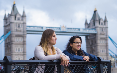 The Tower Bridge London with two girls on a sightseeing tour Stock Photo