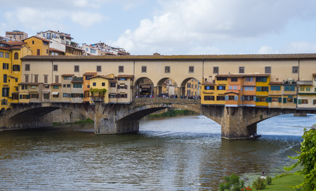 Iconic Vecchio Bridge in Florence over river Arno called Ponte Vecchio - Tuscany, Italy