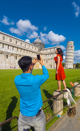 Tourists in Pisa at the most popular place for photos - The Leaning Tower - PISA  TUSCANY ITALY - SEPTEMBER 13, 2017 Editorial