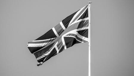 British Flag - Flag of the United Kingdom UK waving in the wind Reklamní fotografie