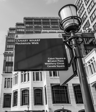 Direction signs at Canary Wharf at MacKenzie Walk - LONDON  GREAT BRITAIN - SEPTEMBER 19, 2016