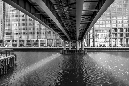 DLR Bridge over Middle Dock in Canary Wharf - LONDON / GREAT BRITAIN - SEPTEMBER 19, 2016