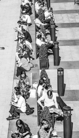 Business People relax at Churchill Place in Canary Wharf - LONDON  GREAT BRITAIN - SEPTEMBER 19, 2016 Editorial