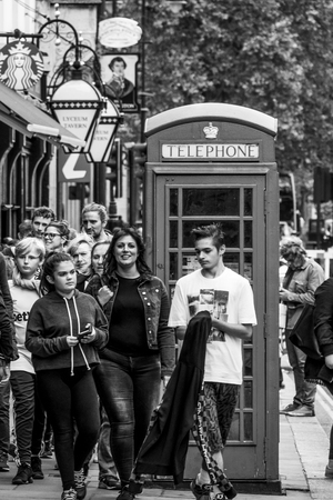 Typical London street view with tourists - LONDON  GREAT BRITAIN - SEPTEMBER 19, 2016