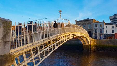 Most famous bridge in Dublin - the HaPenny Bridge over River Liffey