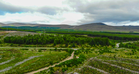 Aerial view over fields in the Scottish Highlands