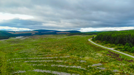 Lonesome street through the Scottish Highlands - aerial view