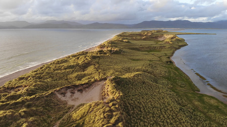 Beautiful grassy dunes at the Irish west coast in the evening - aerial view