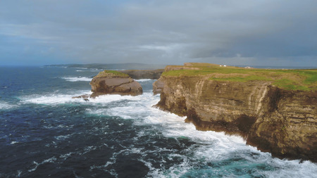 The beautiful cliffs of Kilkee in the evening - aerial drone footage