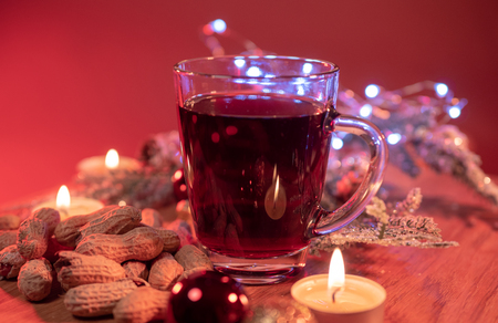 Glass of hot and spiced Christmas punch mulled wine