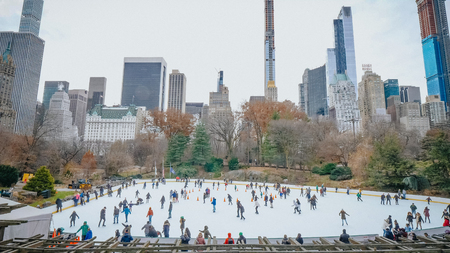 Famous Ice Rink at Central Park at Christmas time - NEW YORK, UNITED STATES - DECEMBER 4, 2018