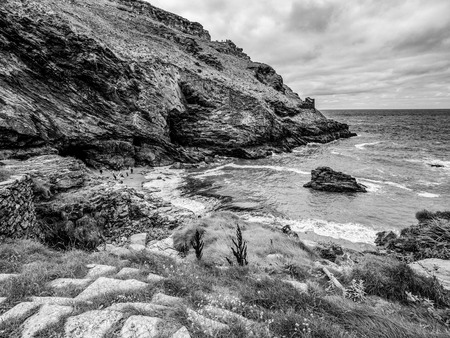 The Cove of Tintagel in Cornwall - a popular landmark at Tintagel Castle Stock Photo