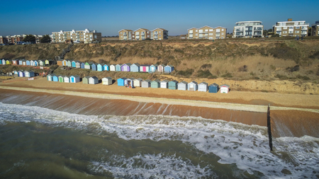 Aerial view over a typical south coast in England with its colorful huts Stock Photo