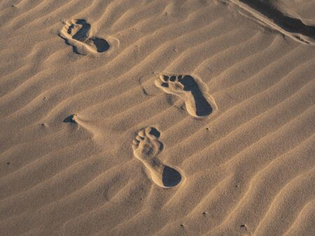 Footsteps in the sand on a beach - travel photography Reklamní fotografie