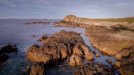 Flight over the beautiful rocky coast of Malin Head in Ireland