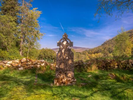 Ancient Celtic Cross in Ireland on a sunny day Stock fotó