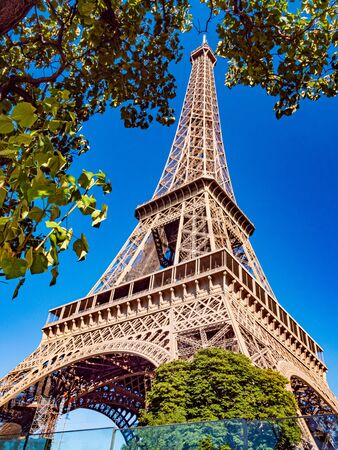 Famous Eiffel Tower in Paris on a sunny day - Paris street photography