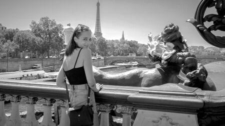 French girl on Pont Alexandre III Bridge in Paris