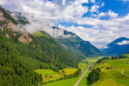 Wonderful aerial view over a valley in the Swiss Alps - Switzerland from above