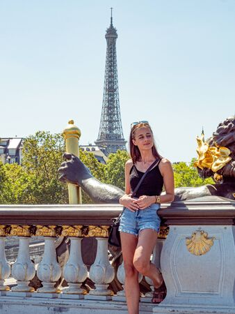 Young woman in Paris with a view over Eiffel Tower