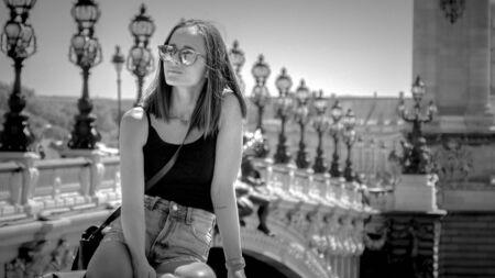 Beautiful girl at River Seine in Paris
