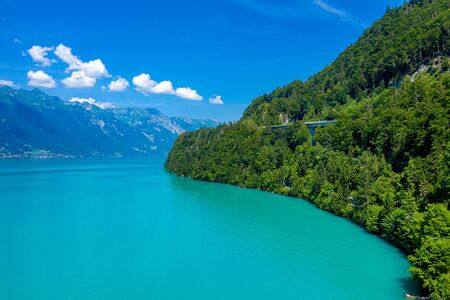 The turquoise water of a wonderful lake in Switzerland - aerial view Reklamní fotografie