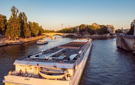 Huge sightseeing vessel on River Seine in Paris - PARIS, FRANCE - JULY 29, 2019 Reklamní fotografie