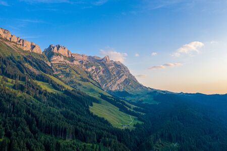 Aerial view over the Swiss Alps at sunset Reklamní fotografie